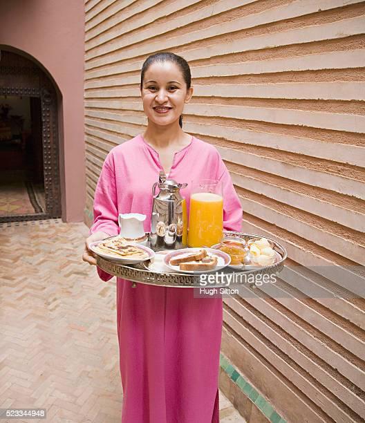 waitress holding breakfast tray - hugh sitton stock-fotos und bilder