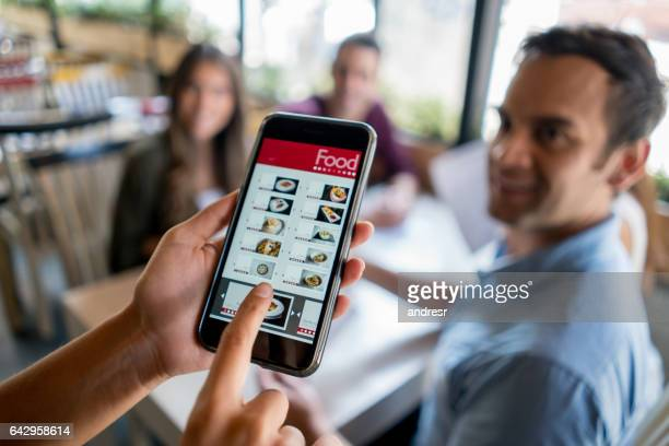 Waitress holding online menu on a smart phone