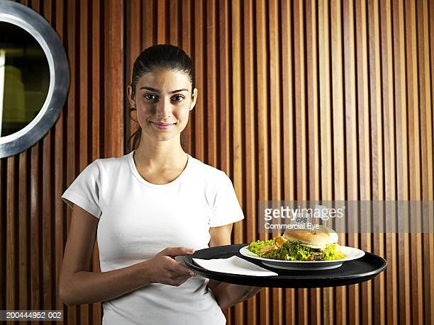 waitress holding tray with burger, portrait - waitress stock pictures, royalty-free photos & images