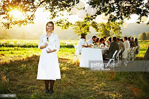 Waitress in front of outdoor banquet table
