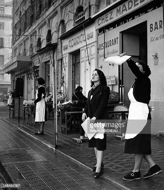 Waitress in front of restaurants in the harbour 1951 in Marseille France