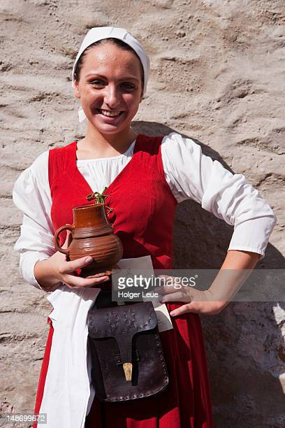 Waitress in medieval costume with mug of beer at Olde Hansa restaurant at Town Hall Square (Raekoja Plats).