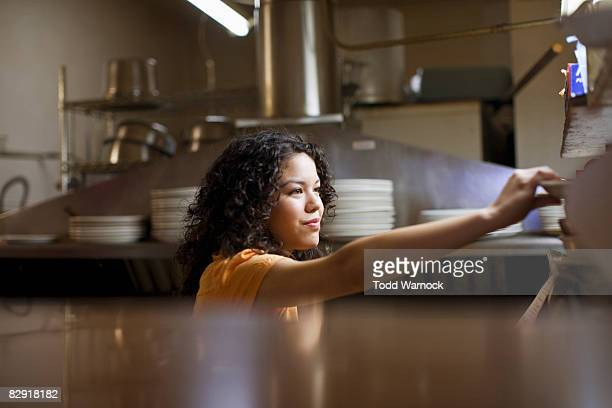 waitress in mexican restaurant