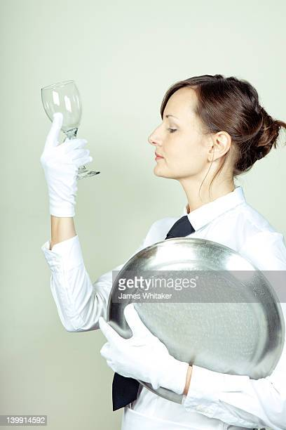 Waitress inspects glass