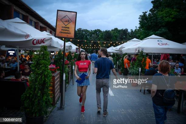 A waitress is seen at the Beraria H food hall in the King Micheal I park in Bucharest Romania on July 24 2018