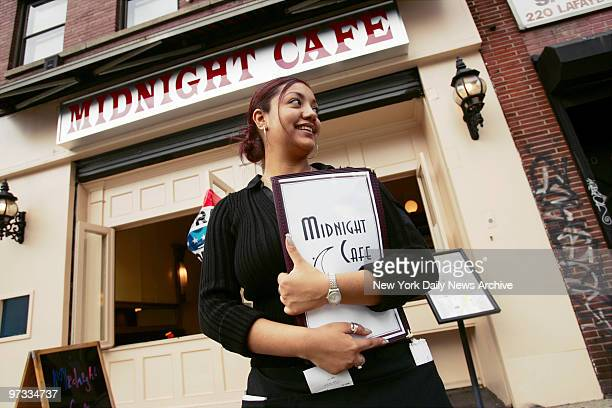 Waitress Lizet Medina waits for customers outside the newlyopened Midnight Cafe II on Lafayette St in Soho The location was formerly occupied by The...