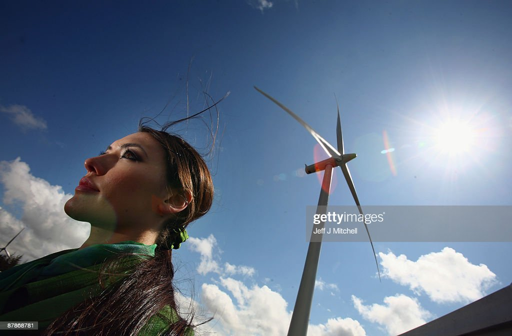 A waitress looks on as Whitelee, Europe's largest onshore wind farm, officially opens on May 20, 2009 in Eaglesham, Scotland. The Whitelee wind farm will power 180,000 homes and has plans granted by the Scottish Government to power a further 70,000.