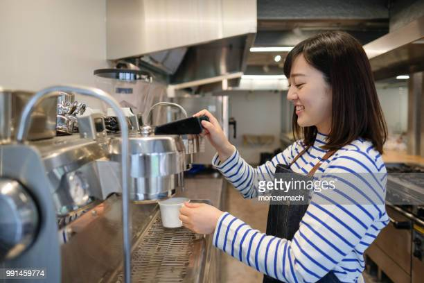 waitress making coffee with coffee machine - part time job stock pictures, royalty-free photos & images