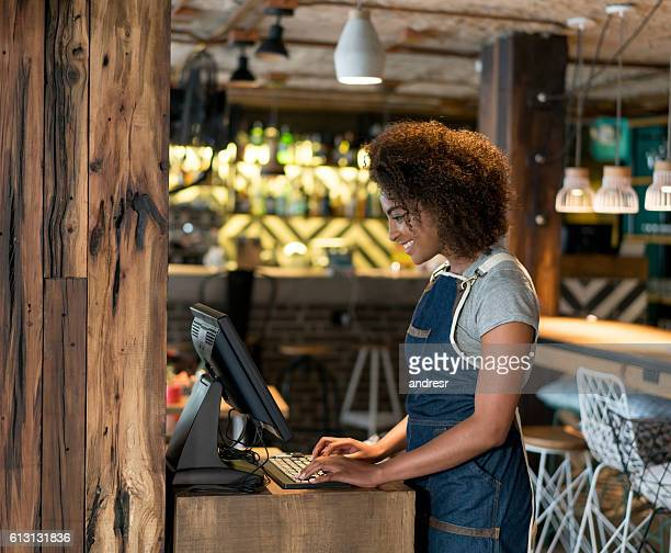 Waitress placing order in the computer