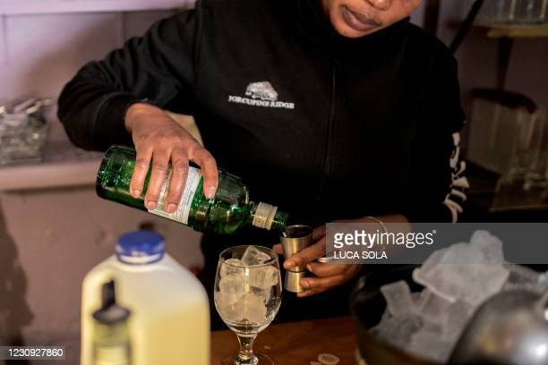 Waitress prepares a cocktail in Espresso restaurant, in Parkhurst, Johannesburg, on February 2, 2021. - South African President Cyril Ramaphosa, on...