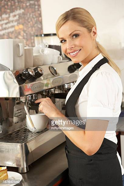 Waitress Preparing Coffee In Café