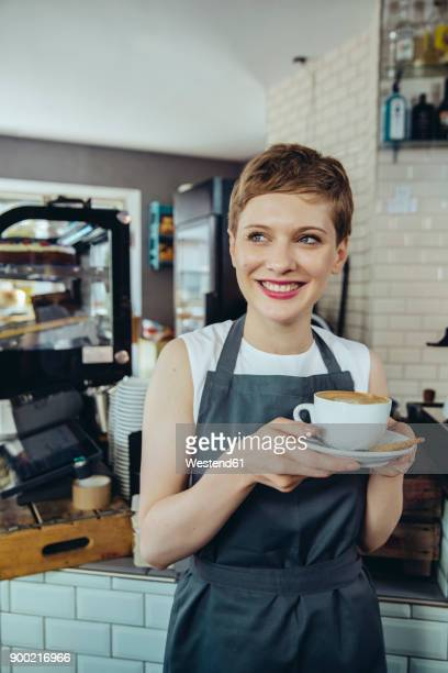 Waitress ready to serve a cup of coffee