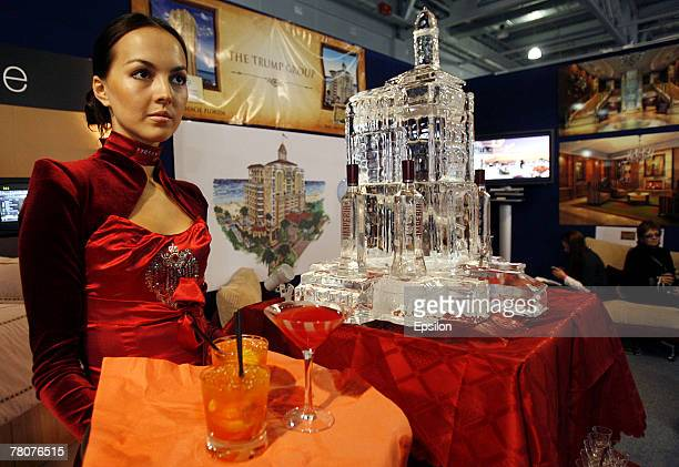 Waitress serves drinks at the Millionaire Fair 2007 at Crocus Expo November 22, 2007 in Moscow, Russia. The Millionaire Fair, the world's largest...