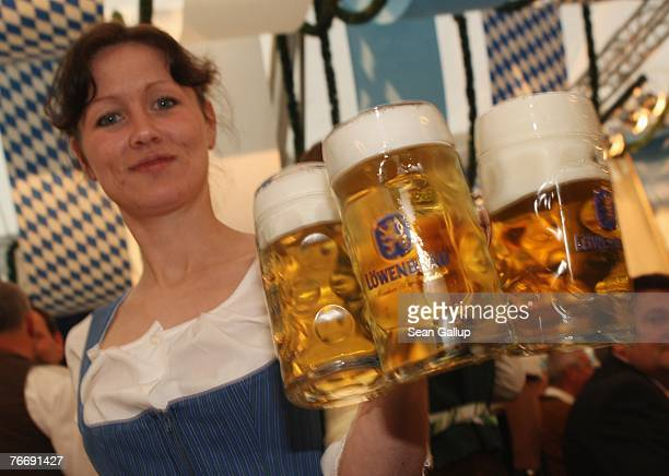 A waitress serves literfull glasses of beer at the Berlin Oktoberfest in front of City Hall September 12 2007 in Berlin Germany The German...