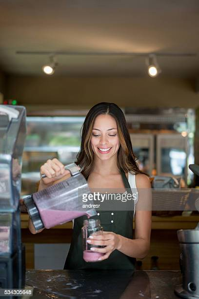 Waitress serving a fresh smoothie