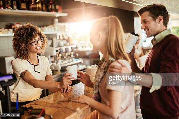 Waitress serving a young couple