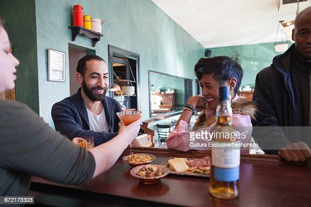 waitress serving customer cocktails at recreational bar - heshphoto stock pictures, royalty-free photos & images