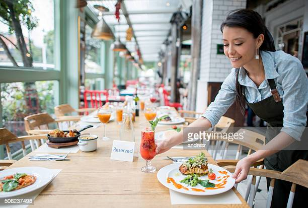 Waitress serving dinner at a restaurant