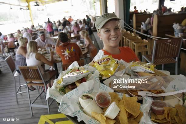 A waitress serving food at Lulu's restaurant