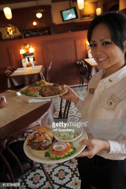 A waitress serving food at Ted's Montana Grill
