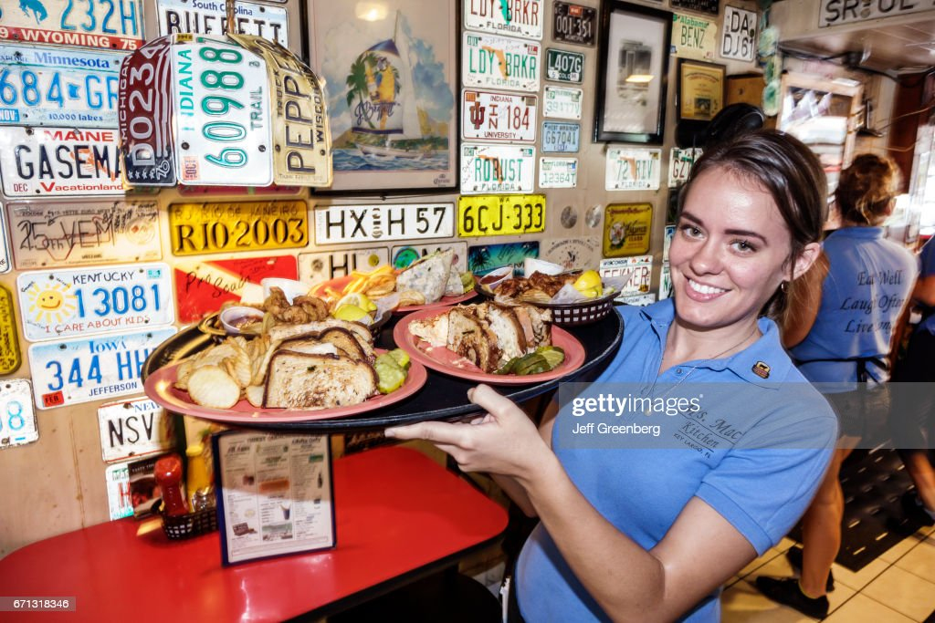 a waitress serving food in mrs macs kitchen - Mrs Macs Kitchen