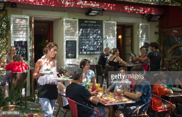 waitress serving food, saint germain, paris, france - terraced field stock pictures, royalty-free photos & images