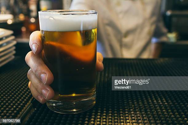 waitress serving fresh beer - beer glass stock pictures, royalty-free photos & images