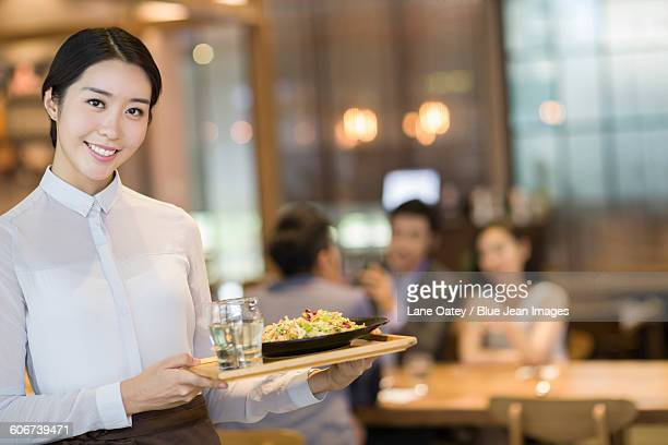 Waitress serving in restaurant