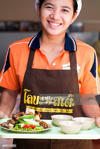 A waitress serving lor bak pork sausage in beancurd skin served with tofu a Baba dish developed in Phuket by Hokkien Chinese who migrated from the...