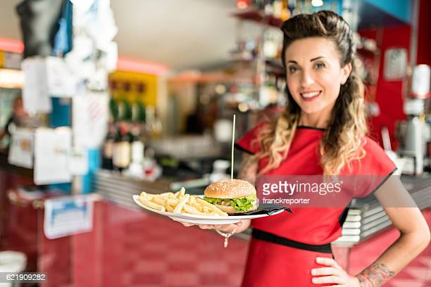 waitress serving the appetitizers at the bar counter