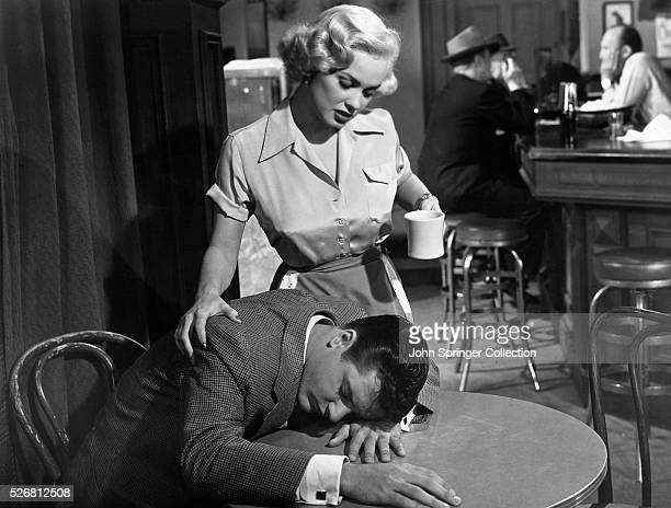 Waitress Sharon Wallace comforts Nick Bonelli as he lays his head on the restaurant table in All American 1953