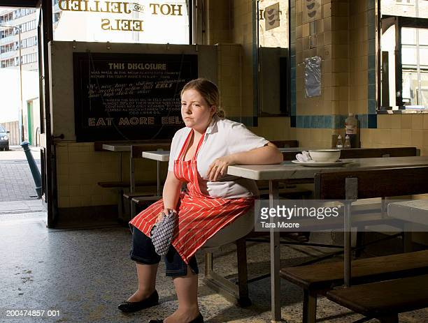 Waitress sitting in cafe