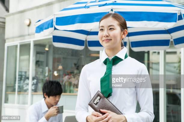 Waitress smiling outside of restaurant