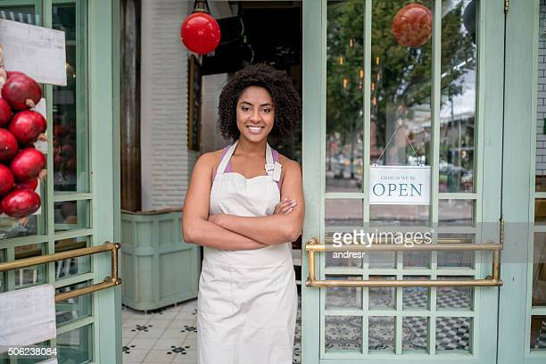 Waitress standing at the door of a restaurant