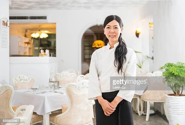 Waitress standing in restaurant