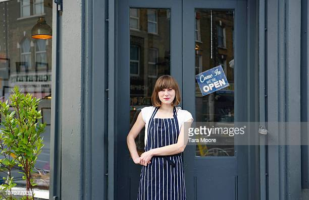 waitress standing outside cafe