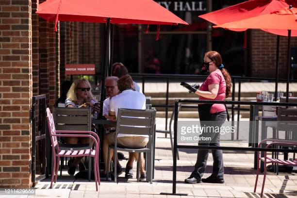 A waitress takes a groups order while they dinein at a restaurant on May 2 2020 in Franklin Tennessee Retail restaurants and some other nonessentail...
