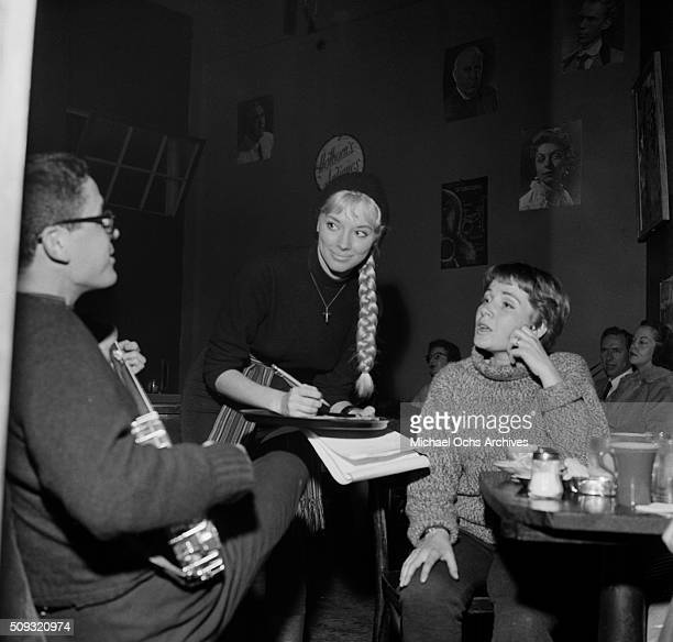 A waitress takes customers drink order at Pandora's Coffee House on Sunset Boulevard in Los AngelesCalifornia