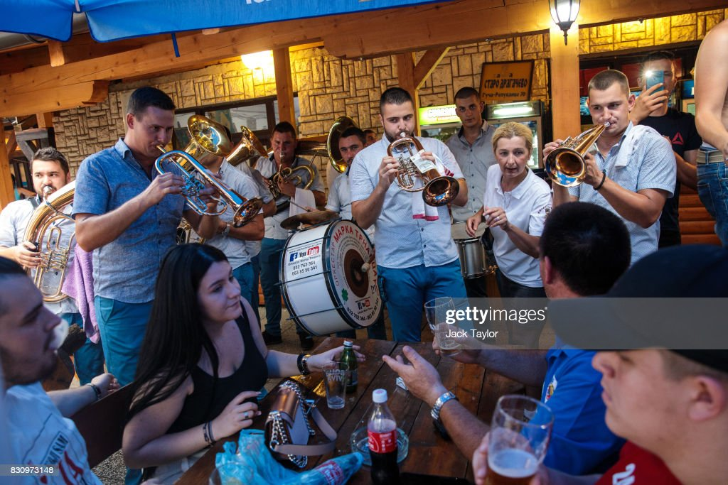 A waitress takes drinks orders from a table as a brass band plays in a restaurant during the Guca Trumpet Festival on August 11, 2017 in Guca, Serbia. Thousands of revellers attend the trumpet festival, held annually since 1961 in the small, central Serbian town of Guca. The free event is a celebration of Balkan music with dozens of orchestras and solo trumpeters taking part in the festival's main competition. During the festival wild street parties take place throughout the night as brass bands parade and play for tips to the thousands of visitors in the town's restaurants, bars and pop-up tents.