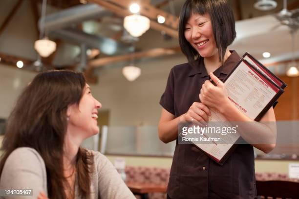 Waitress taking customer's order