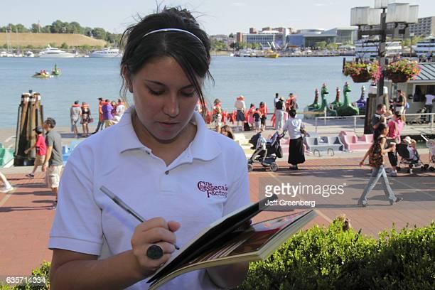 Waitress taking order at Cheesecake Factory restaurant next to the Patapsco River