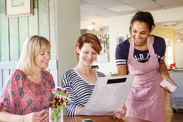 Waitress taking order from daughter and mother.