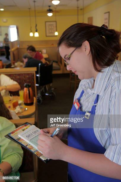 A waitress taking order in a Restaurant at Port Charlotte