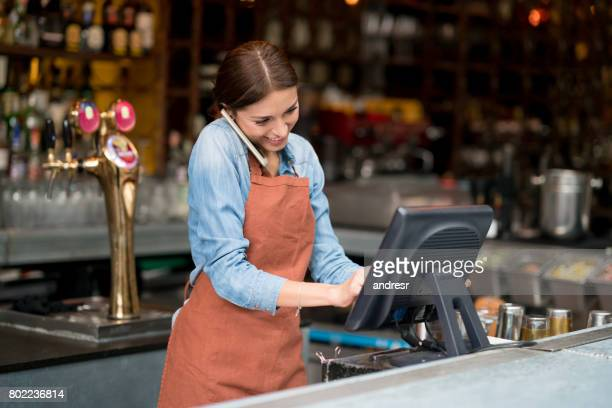 waitress talking on the phone at a restaurant - ordering stock pictures, royalty-free photos & images