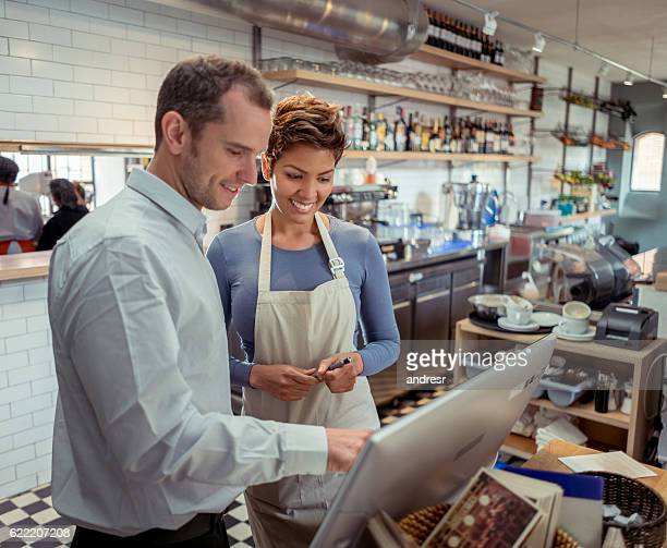 Waitress talking to manager at a restaurant