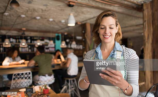 Waitress using a tablet computer