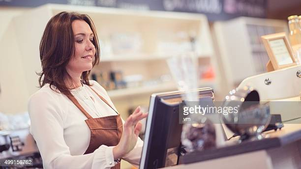 Waitress using touch screen cash register