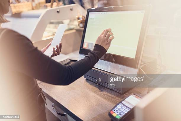 waitress using touchscreen computer at the bar counter - cashier stock pictures, royalty-free photos & images