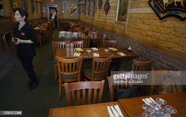 A waitress waits for the arrival of Westchester County Executive George Latimer and New Rochelle Mayor Noam Bramson for lunch at Eden Wok Kosher...
