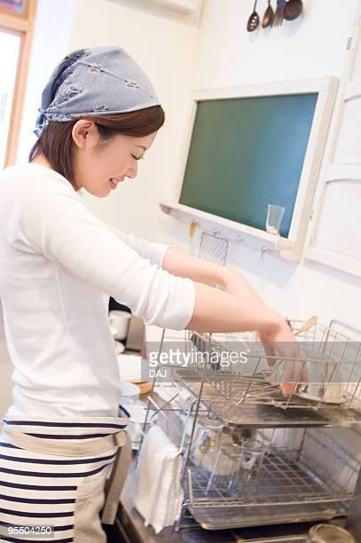 Waitress washing dishes